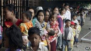 Cambodian villagers and their children outside hospital