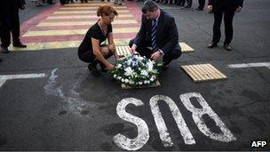 Israeli Tourism Minister Stas Misezhnikov (right) pays his respects to the five Israeli victims of a suicide blast which targeted a bus of Israeli tourists, during a commemoration ceremony at the site of the blast at Burgas airport in Bulgaria on Tuesday