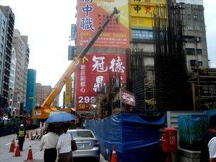 A construction site in operation in a neighbourhood in Taipei, 16 July 2012