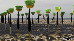 Brooms placed on the beach in a protest at political corruption
