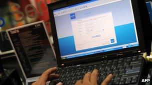A consumer using a laptop to connect to the internet in Malaysia