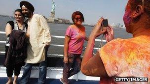 Indian-Americans celebrate the Holi festival in New York near the Statue of Liberty