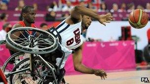 USA's Trevon Jenifer falls from his wheelchair during the men's wheelchair basketball bronze medal match