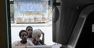 Children watching TV through a window