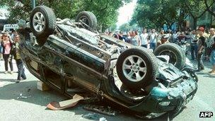 A Japanese-made car is overturned on the streets of Xian, China, during anti-Japanese protests on Saturday