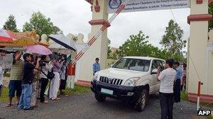 Car leaving the UN-backed court in Cambodia