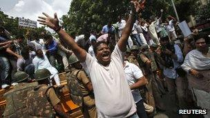 """A supporter of India""""s main opposition Hindu nationalist Bharatiya Janata Party (BJP) shouts anti-government slogans during a protest against rise in fuel prices and Foreign Direct Investment (FDI) in New Delhi September 15, 2012."""