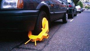 A wheel clamped car