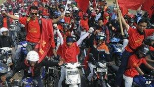 Factory workers protesting in West Java, Indonesia, 3 October 2012