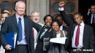 Lawyer Martyn Day (l) and supporters of a group of Kenyans who allege abuse by British colonial authorities celebrate as they leave the High Court