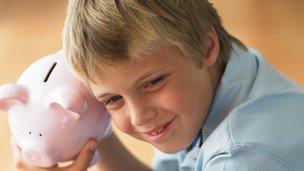 Boy and piggy bank