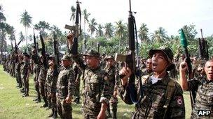 Moro Islamic Liberation Front (MILF) rebels raising their rifles during during a ceremony in Mindanao, 14 October 2012
