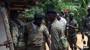 Soldiers inspect aftermath at barracks