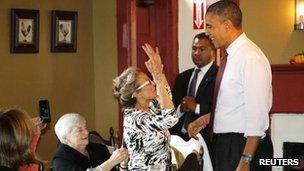 Barack Obama greets a diner in a restaurant in Merrimack, New Hampshire 27 Oct