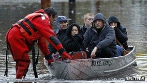 People in a boat (Image: Reuters)