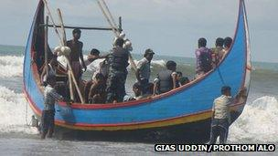 Some survivors of the capsized boat off Bangladesh