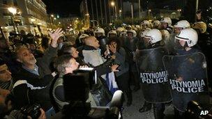 Protesters confront riot police in Athens. Photo: 11 November 2012
