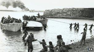 British troops escape the sinking of the Sir Gallahad landing ship in 1982