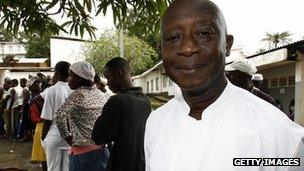 Charles Margai of the People's Movement for Democratic Change (PMDC) waits to cast his vote in the first round of presidential elections 11 August 2007 in Freetown.