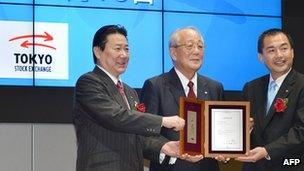 Japan Airlines president Yoshiharu Ueki, chairman Kazuo Inamori and chairman Masaru Onishi