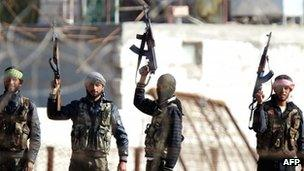 Syrian opposition fighters celebrating on the strategic Syrian border town of Ras al-Ain (15 Nov 2012)