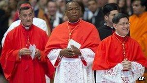 New cardinals Bechara Boutros Rai, Patriarch of Antioch of the Maronites in Lebanon, Nigeria's Archbishop John Olorunfemi Onaiyekan, and Philippines Archbishop Luis Antonio Tagle in the Vatican (24 Nov 2012)