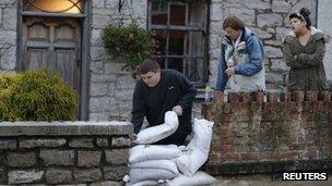 Man and sandbags
