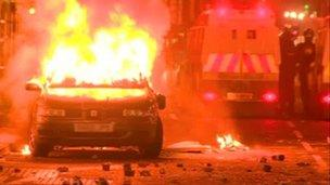 Car on fire during protest