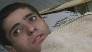 A video posted online by opposition activists purported to show a young Alawite boy who survived the events in Aqrab