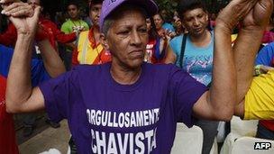 Supporters of Venezuelan President Hugo Chavez prayed during a mass in Caracas on December 11, 2012.