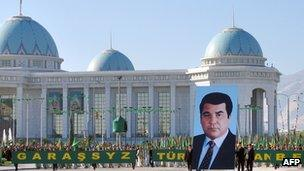 Participants in a parade carry a massive portrait of Saparmurat Niyazov at a parade in Ashgabat in 2005