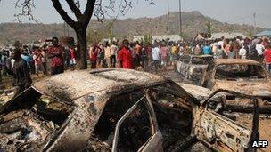 Burnt cars outside St Theresa Catholic Church in Abuja (December 25 2011)