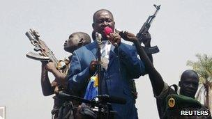 Central African Republic President Francois Bozize (C) speaks to a crowd of supporters in Bangui - 27 December 2012
