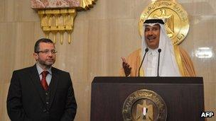 Qatari Prime Minister Hamad bin Jassim al-Thani (R) speaks during a joint press conference with Egyptian Prime Minister Hisham Qandil after a meeting with Egyptian President Mohamed Morsi in Cairo, 8 January 2013