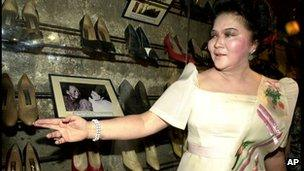 Imelda Marcos with some of her shoes on display at a museum in Marikina City (Feb 2001)