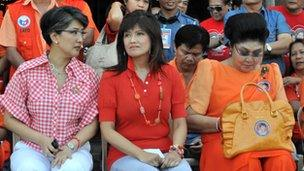 Imelda Marcos (R) and her two daughters, Imee and ??