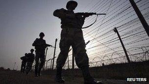 Indian Border Security Force (BSF) soldiers patrol the fenced border with Pakistan in Suchetgarh, southwest of Jammu January 16, 2013.
