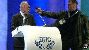 File image taken from video shows a man identified as Oktay Enimehmedov (R) as he points a weapon at Ahmed Dogan, 19 January 2013