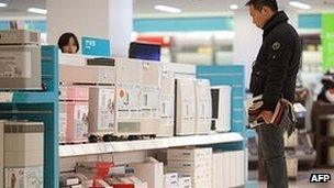 A man shops for air purifiers in Beijing on January 15, 2013