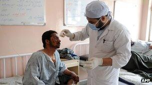 Wounded Afghan policeman receives treatment on 27 January 2013