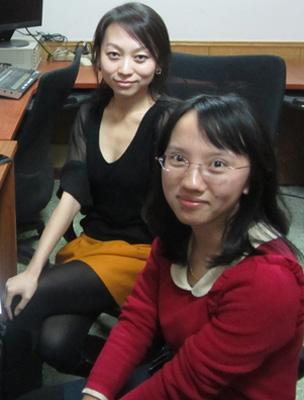 """Huang Yuanyuan (front right) and a fellow """"leftover"""" colleague, Wang Tingting, at their radio station in Beijing"""