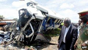 Deputy minister for Works and Supply Colonel Panji Kaunda with a Provincial Army representative inspects the scene of the crash on Thursday