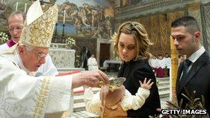 Pope Benedict XVI performs a baptism in the Sistine Chapel (13 January 2013)