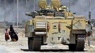 British tank and civilians in Basra 2003