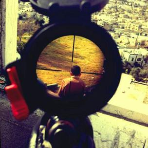 Picture posted on Instagram showing Palestinian child in crosshairs of sniper's rifle