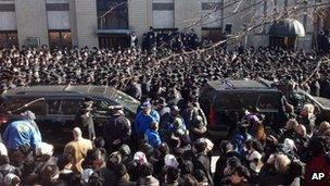 The Orthodox Jewish community gathers at the funeral of Nachman and Raizy Glauber in Williamsburg, New York 3 March 2013