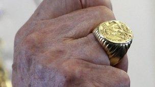 File image of Joseph Ratzinger, the emeritus pope, wearing his papal ring