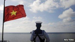 A Vietnamese naval soldier stands quard at Thuyen Chai island in the Spratly archipelago on 17 January 2013