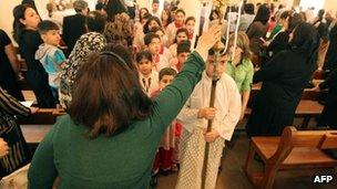 Christians attend church in Baghdad, Iraq, 31 March