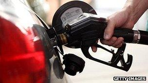 close-up of car being filled with petrol